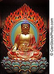 Golden buddha statue - Golden statue of buddha inside a...