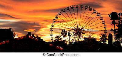 Carnival At Dusk - Panorama of a carnival silhouetted...