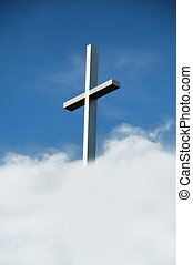 The Cross - steel Christian cross against blue sky and...