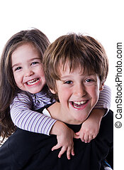 Happy kids - brother and sister ona white background...