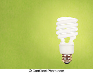 compact fluorescent bulb on green