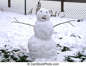 Snowman with stick arms, carrot nose and black eyes and...