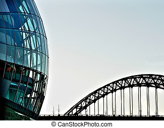 Rounded glass building and Tyne bridge