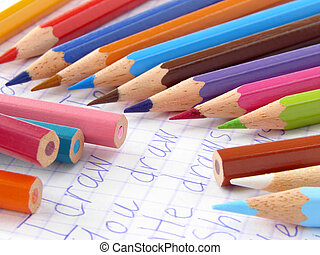 primary school - color pencils and open exercise book...