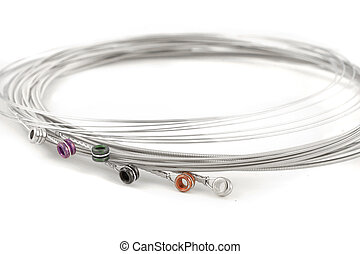 guitar strings - a set of electric guitar strings on a white...