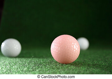 Pink golfballs with white friends waiting for continous...