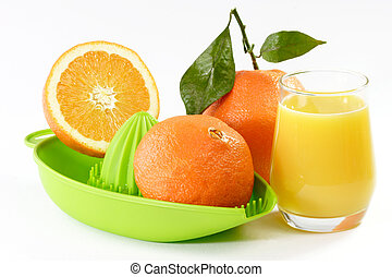 Orange Juice with fruits and a green juicer