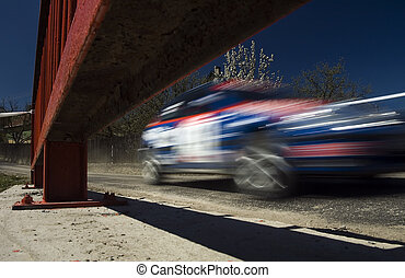 rally motion - blurred rally car in motion on a bridge,...