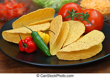 Tacos and Ingredients - Taco shells, tomatoes, habanero and...