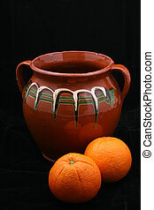 ceramic pot and oranges