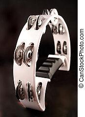 tambourine - black and white percussion tambourine on black...