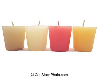 Four Candles - A set of colorful candles lined up in...