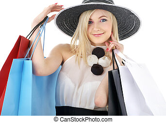 portrait of blond in hat with shopping bags - elegant blond...