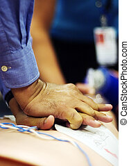CPR - Hands of a CPR administrator on the chest of a...