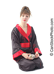 girl and cup of tea 1 - attractive girl in kimono sitting...