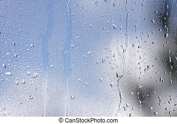 Rain Drops on Window as the clouds clear behind.