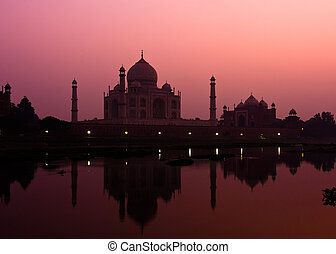 Taj Mahal at dusk - Sunset view of the Taj Mahal reflecting...