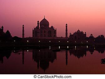 Taj Mahal at dusk - Sunset view of the Taj Mahal reflecting...