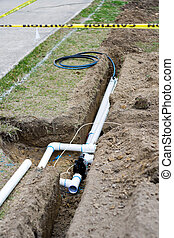 Irrigation System Installation - trenches and pipe for...