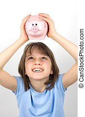 Girl looking at her piggy bank - A young girl trying to get...