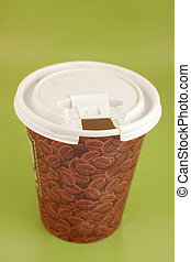 take-out coffee - a cup of coffee to go on a green...