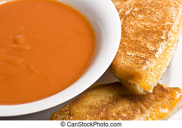 cheesy - grilled cheese sandwich on a white plate shot with...