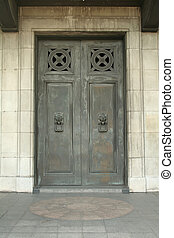 Gothic Doorway With Lion Knockers as Handles - Morbid gothic...