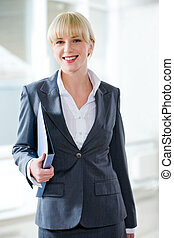 Professional - Portrait of smiling professional holding a...