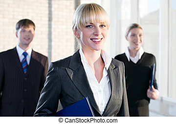 Leadership - Portrait of female leader on the background of...