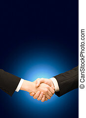 Shaking hands - Vertical image of successful handshake of...
