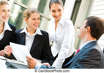 Teamwork - Image of three women looking at business man in a...