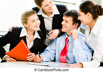 Business group - Portrait of four business people discussing...
