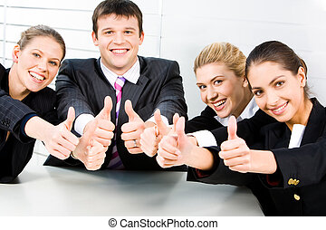 Friendly team - Four smiling business people sitting and...