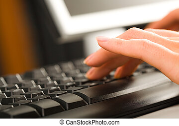 Typing documents - A secretary typing business documents on...