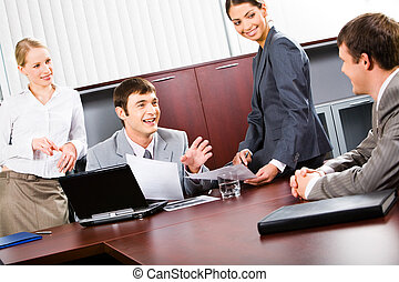 Teamwork - Portrait of confident business people discussing...