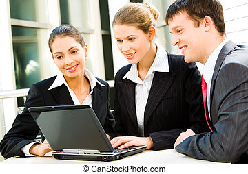Group work - Group of three business people sitting and...
