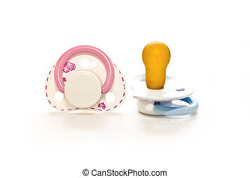 boy and girl - couple Baby pacifier on white with soft...