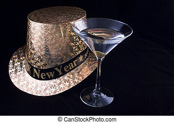New Years Martini - A New Years Eve party hat and a full...