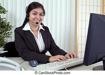 Attached to the Helpdesk - A friendly young woman working at...