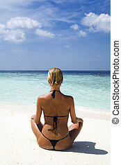 tropical beach: perfect girl meditating on a tropical beach...