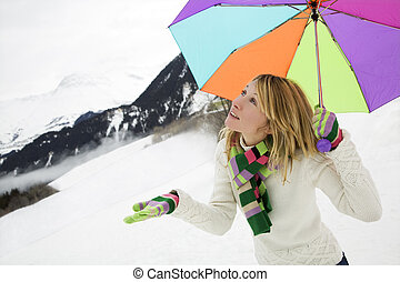 winter scene: girl checking out if it\\\'s snowing. Copy...