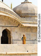Yellow sari at Amber fort - An indian woman dressed in a...