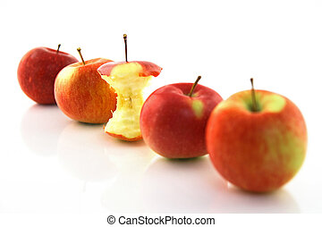 Apple core among whole apples, focus on the core - Apple...