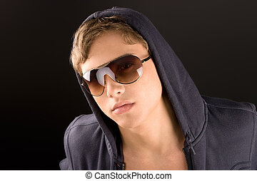 Young fashion man model posing in sun glasses