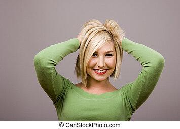 Blonde Mussing Hair Hands Behind Head