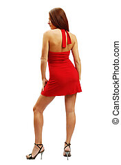 Woman in red short dress standing back, isolated on white...