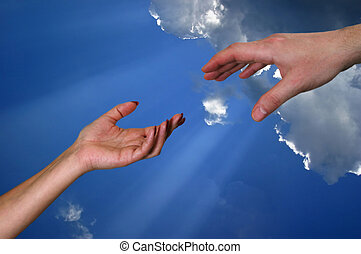 Helping hand - Man\\\'s and female hand on a background of...
