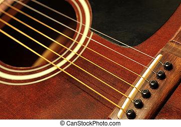 Guitar close up - Acoustic guitar bridge and strings close...
