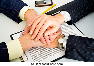 Business support - Photo of two business partners holding...