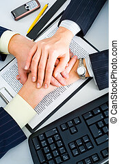 Partnership in business - Two business people�s hands on...